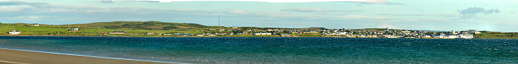 Picture of a panoramic view over a coastal village on the shore of a sea loch