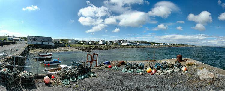 Picture of a panoramic view over a village with a distillery (Bruichladdich on Islay)