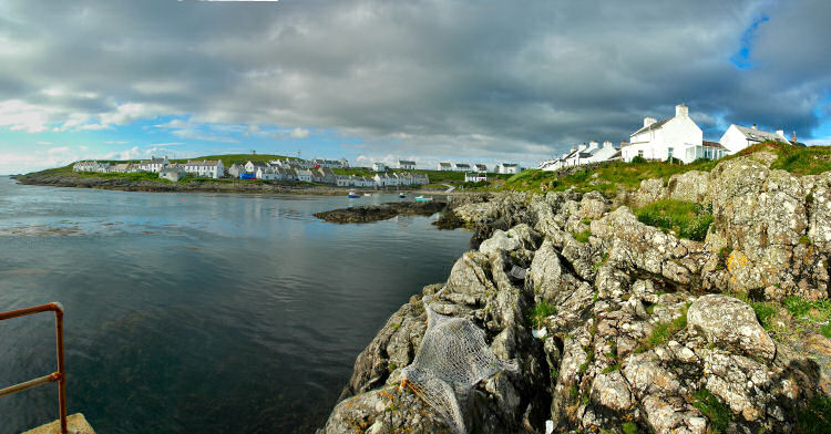 Picture of a panoramic view over a coastal village around a small bay (Portnahaven on Islay)